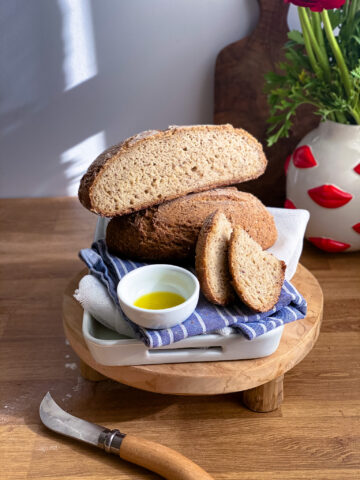 Gluten-free artisan bread loaf with oil bowl