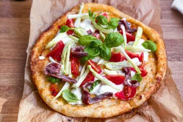Sourdough gluten free pizza with anchovies, mozzarella and greens