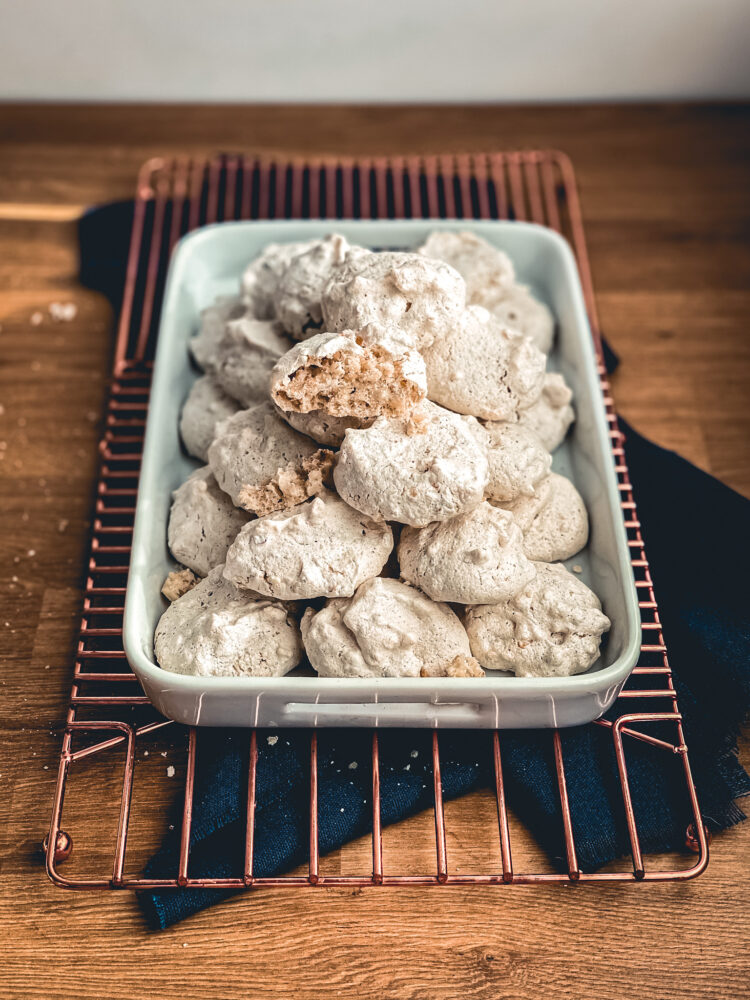 Hazelnut meringue cookies piled on a tray