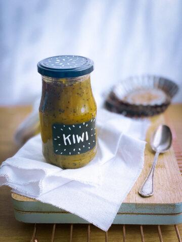 Spicy kiwi jam jar on a board