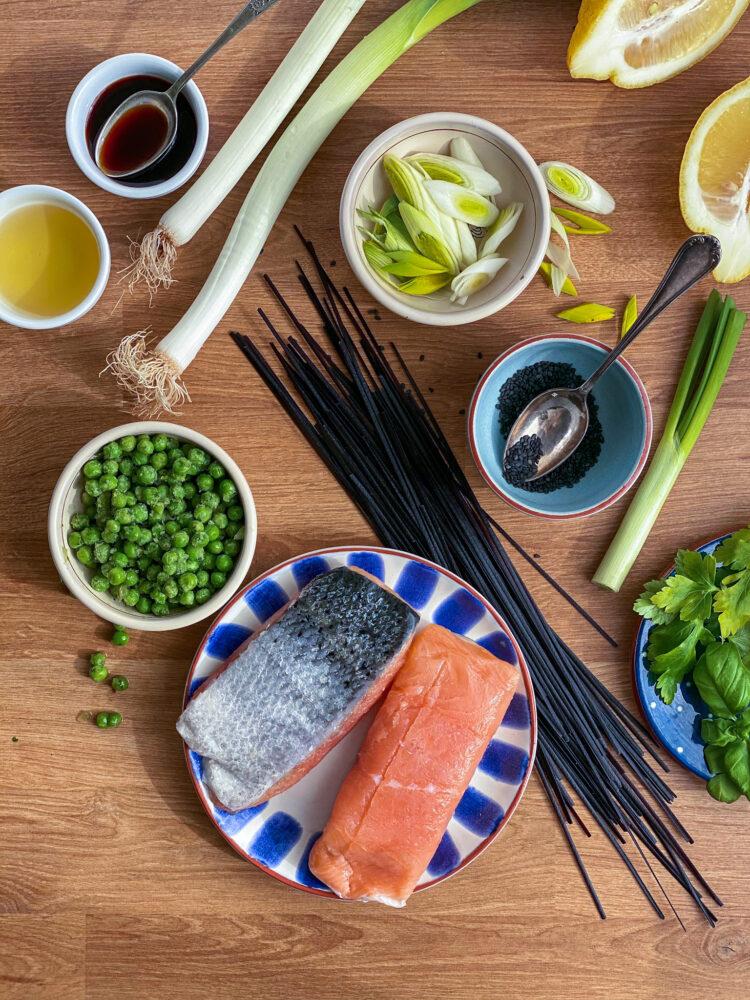 Salmon and peas stir fry noodles ingredients on flatlay