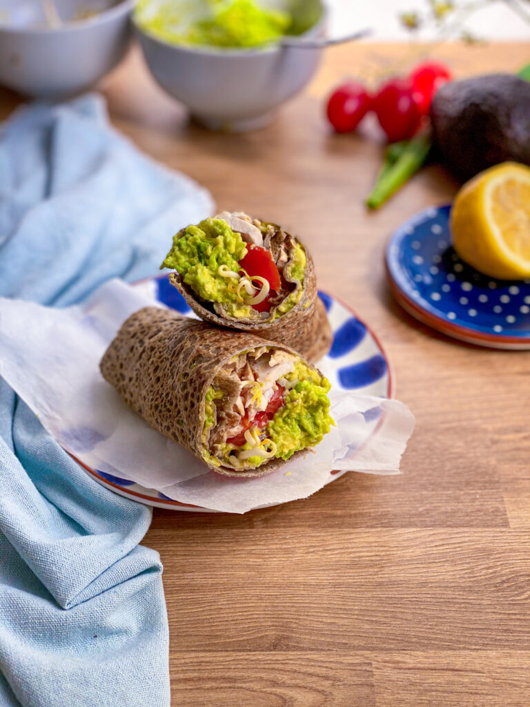 Buckwheat wrap filled with veggies on a plate