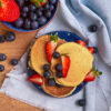 Gluten free fluffy pancakes with berries