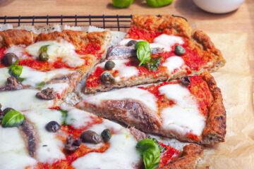 Gluten free pizza with mozzarella and anchovies
