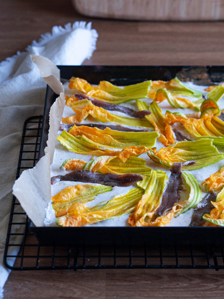 Zucchini blossom and anchovies flatbread