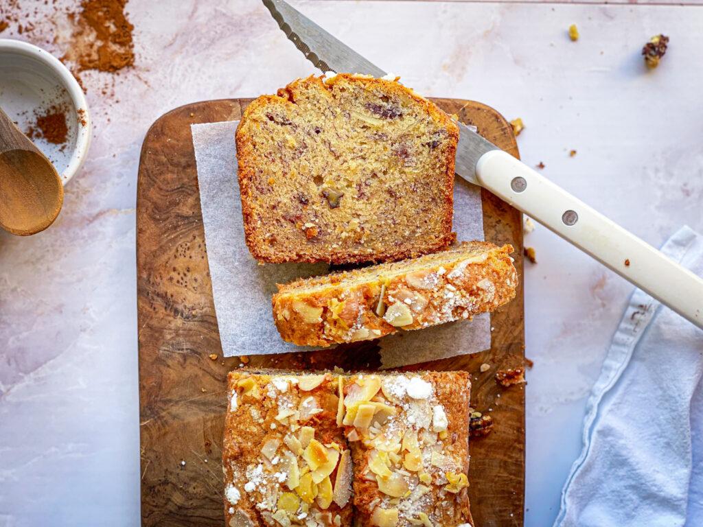 Gluten free banana bread sliced with knife